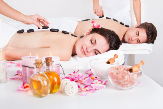 Beautiful Young Couple Having A Stone Massage In A Spa Center