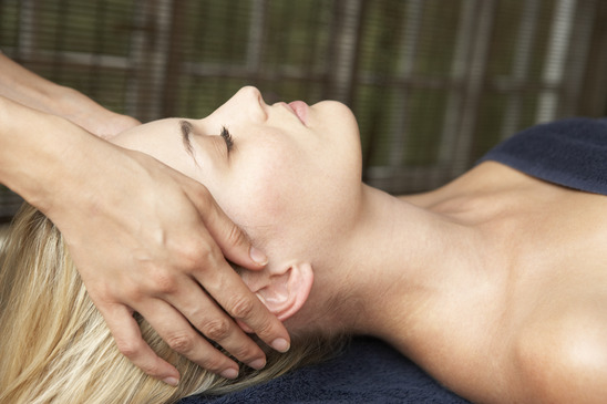 Young Woman Relaxing On Massage Table